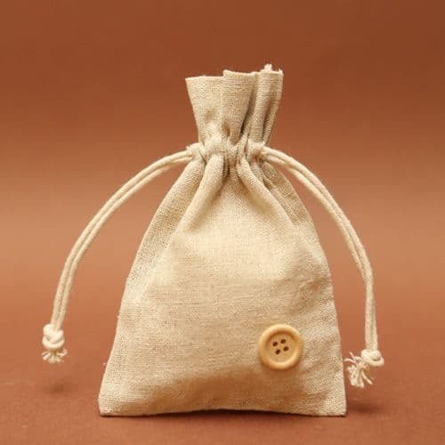 Linen pouch favour with button / Μπομπονιέρα απο λινό πουγγί με κουμπί
