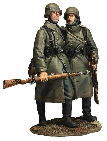 WB25060 German Helping Wounded Comrade in Greatcoat