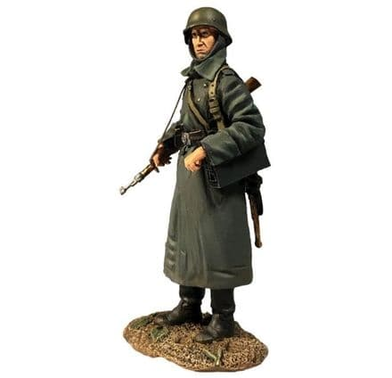 WB25077 German Volksgrenadier Standing with Ammo Can in Greatcoat